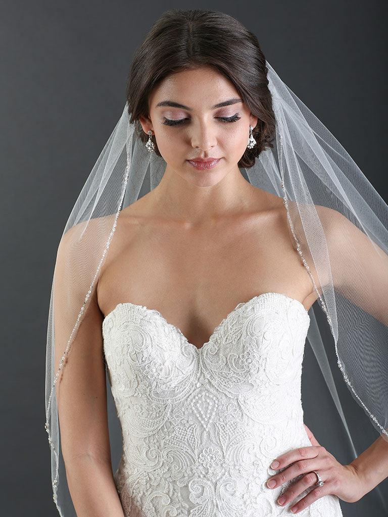V7475   1-tier fingertip veil with sparkling edge of beads, crystals and rhinestones.