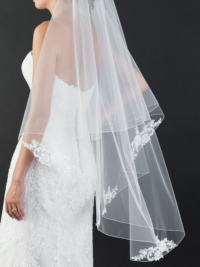 V7465   Foldover rolled edge knee length veil with delicate lace appliqués