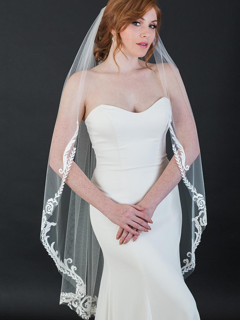 V7432   1-tier knee length veil with dramatic scroll and vine lace