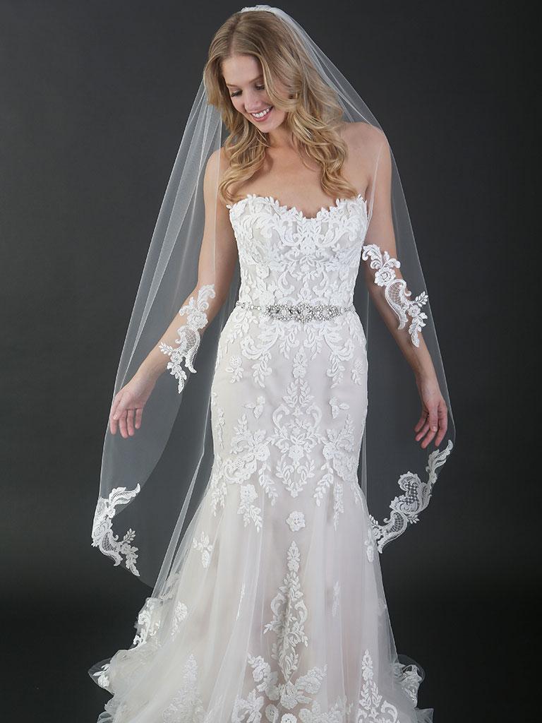 V7477   1-tier cut edge waltz length veil with sequined lace appliqués