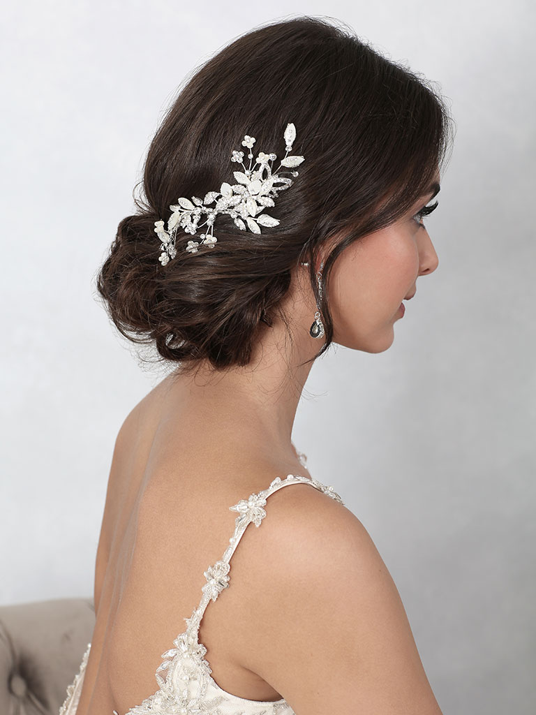 6866   Stylish clip of ivory mother-of-pearl flowers, leaves, and rhinestones