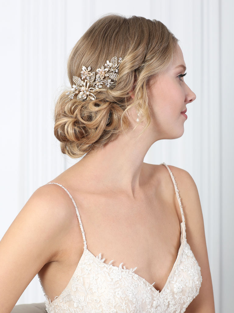 6879   Graceful clip of rhinestone leaves, metal flowers and champagne pearls