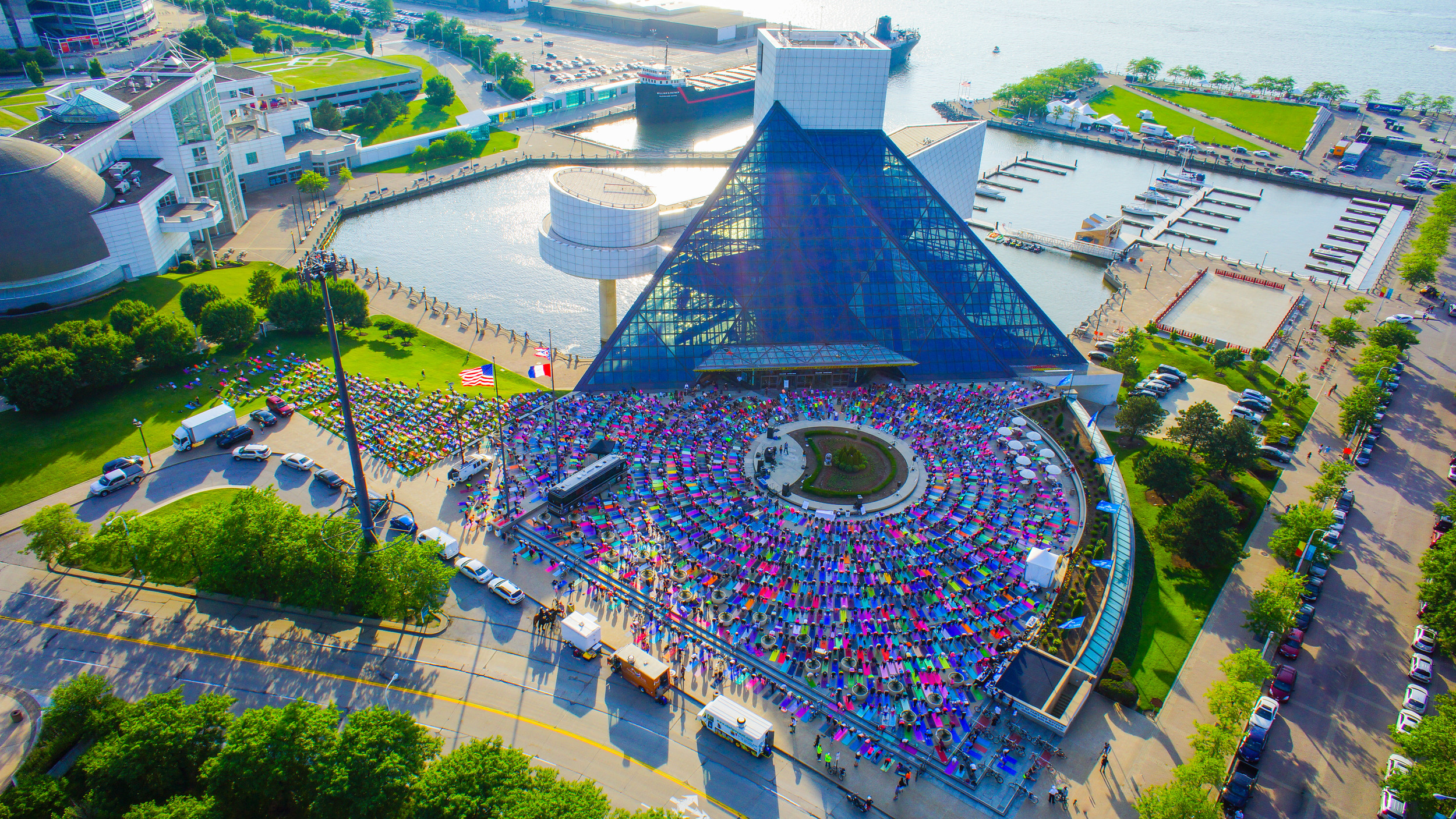 Here's what happens when over 2,200 yogis congregate on the plaza of the world-famous Rock and Roll Hall of Fame and Museum to breathe love, light and energy into our beautiful city!  The yogis ROCKED CLE!   Click here for more stunning photos!   Be sure to check out  Believe In CLE  and  Inner Bliss Yoga Studio  for more upcoming events!