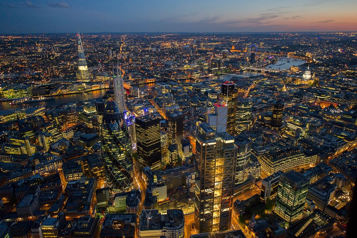 "London, England (The City)    London's financial district is all aglow, featuring ""the Gherkin"" building.   ( via )"