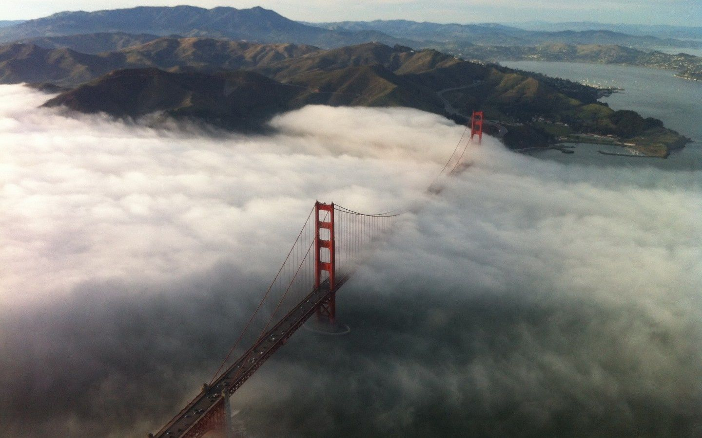 Golden Gate Bridge, California    The Golden Gate Bridge and fog—two enduring San Francisco institutions. ( via )