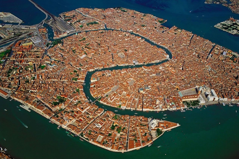 Venice, Italy    The entire city of Venice is named a UNESCO World Heritage Site, thanks to the fact that it's absolutely stunning and, you know, has canals instead of roads. ( via )