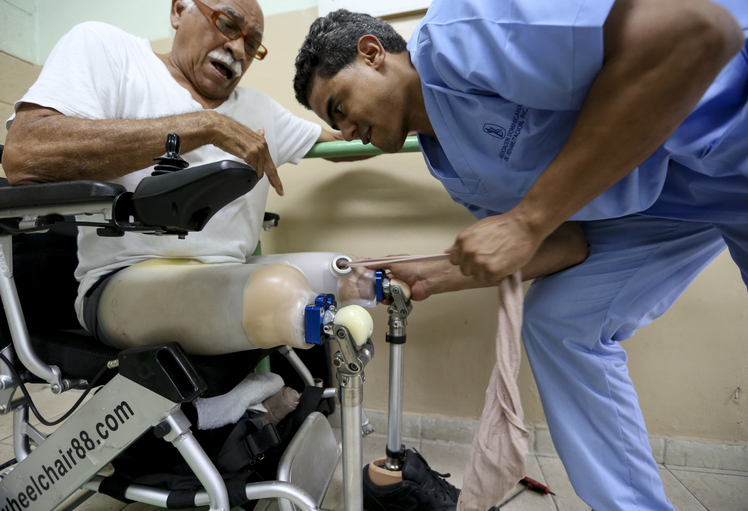 A double amputee gets his prosthetics fitted in Santo Domingo, Dominican Republic.