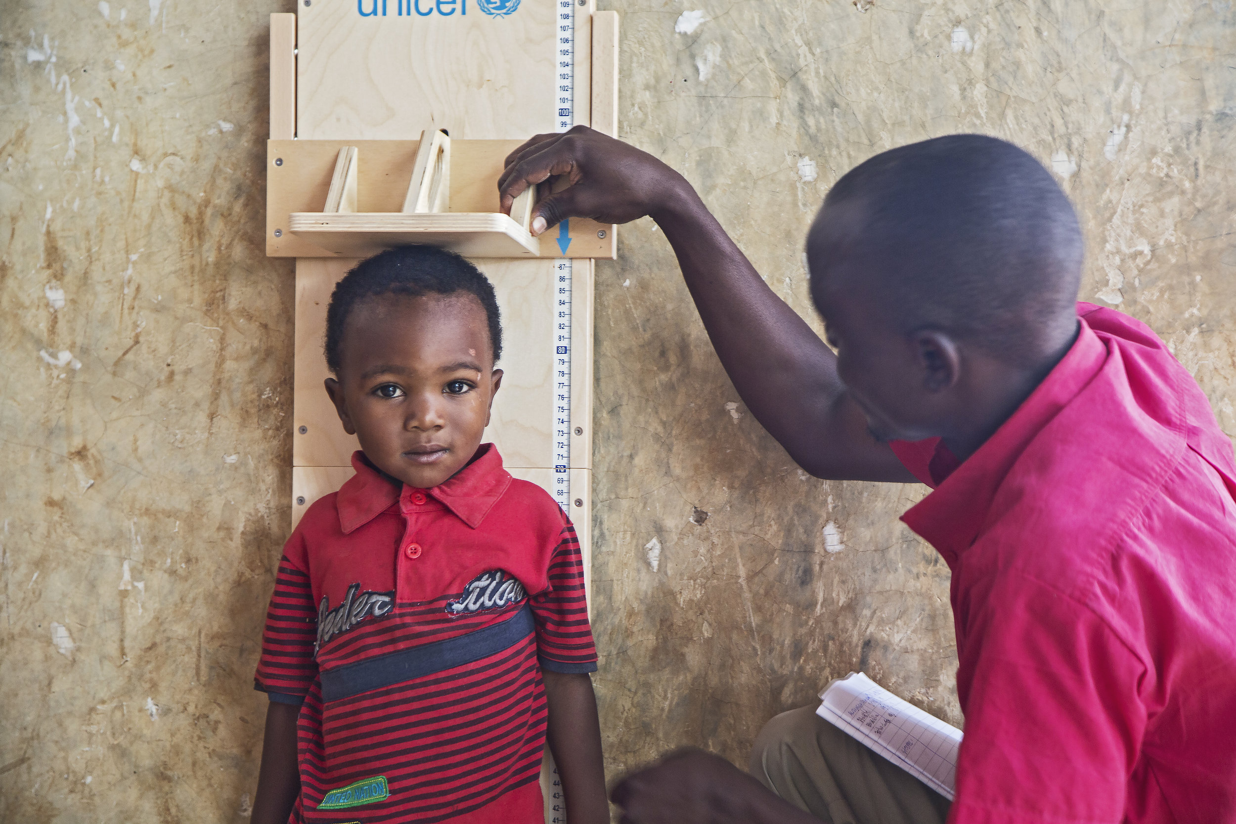 Measuring a child in the Songwe region of Tanzania as part of the effort to reduce stunting in the region.