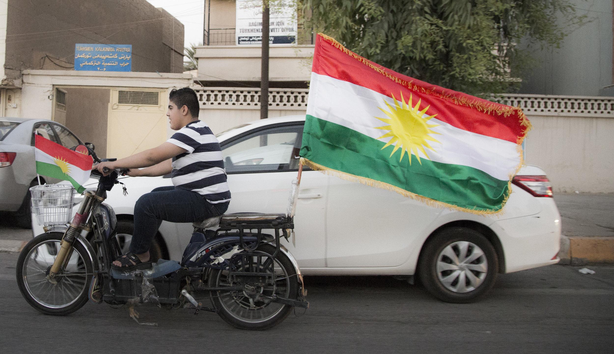 A young man speeds through Erbil, Iraq ahead of the Kurdish independence referendum.