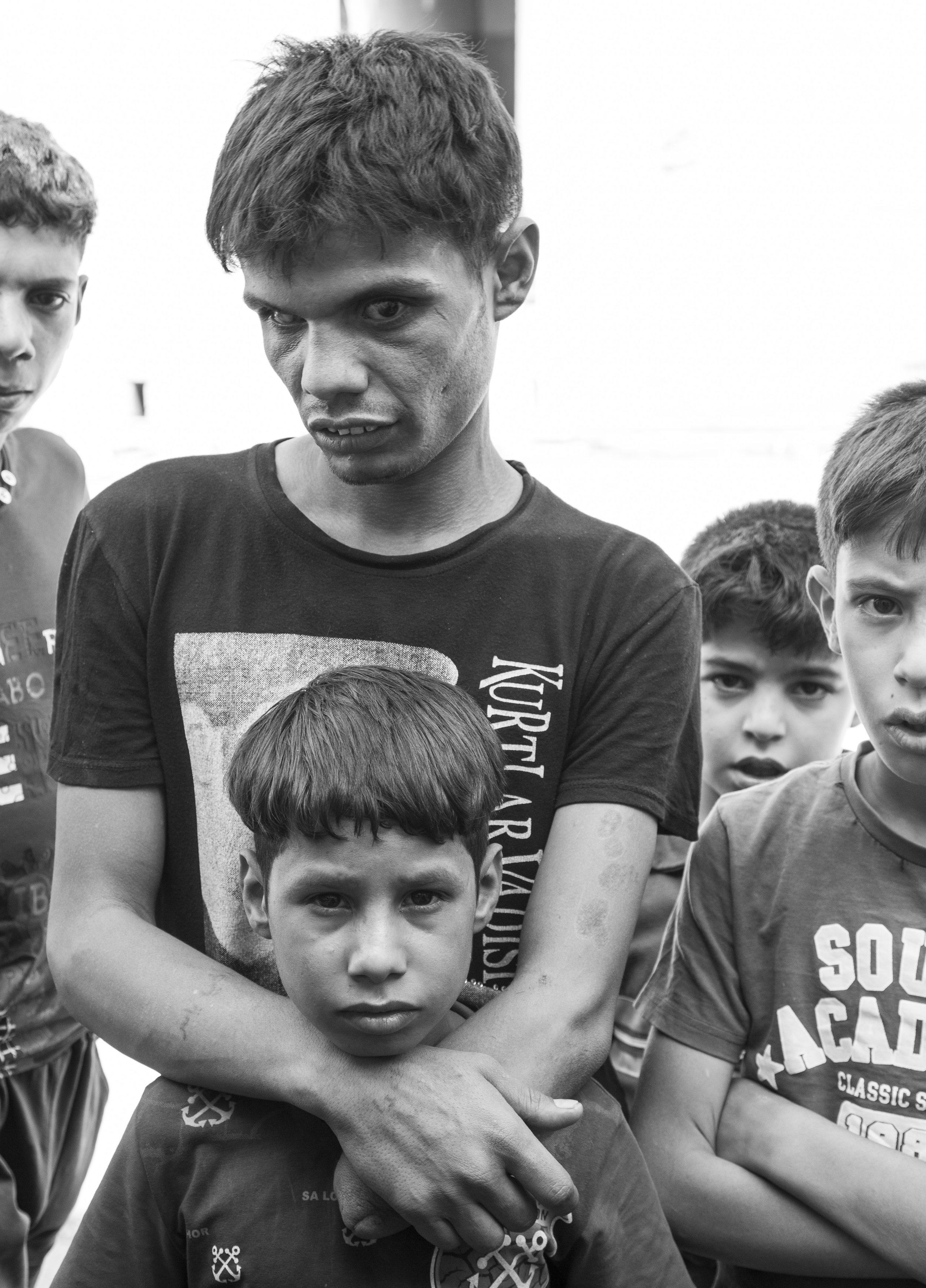 Young men and boys in West Mosul. The group of children are living together after their families were killed by ISIS.