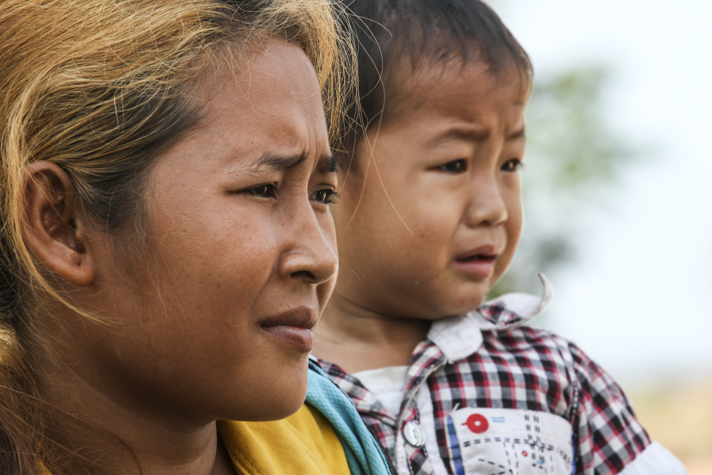 A WORTH member and child in Cambodia.