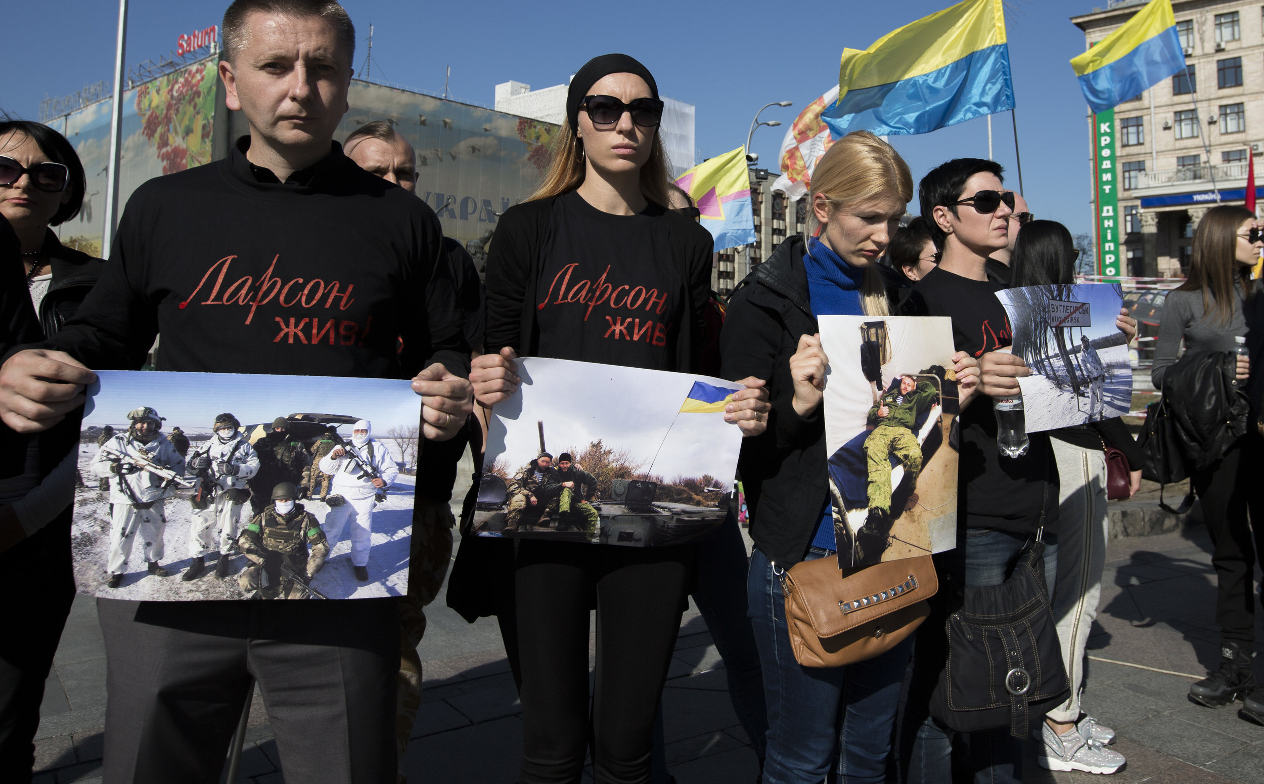 In a silent protest family members in Kiev hold photos of loved ones killed in the ongoing conflict in eastern Ukraine.