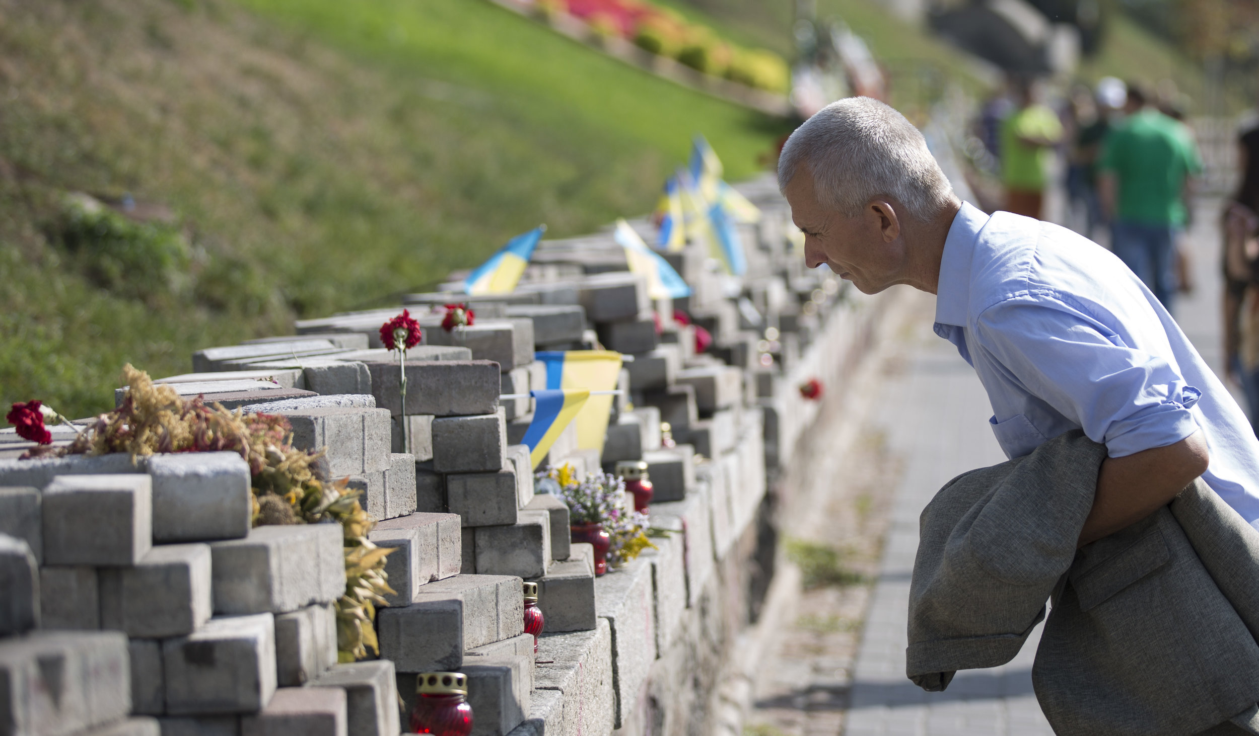 A man views a street memorial of those who lost their lives during the Euromaidan revolution.
