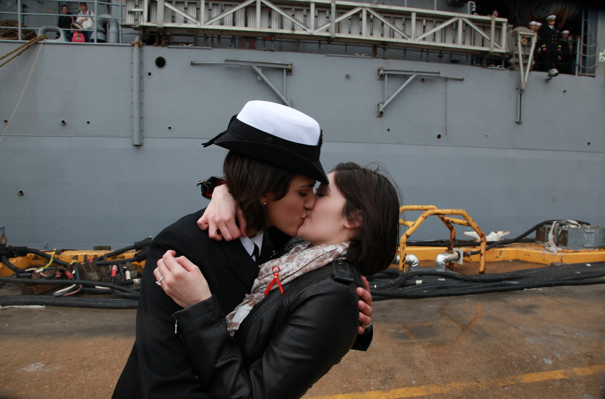 "Two female sailors kiss as the Navy tradition of ""first kiss"" catches up with repeal of the ""don't ask, don't tell"" policy that previously barred openly gay men and women from serving in the U.S. military."