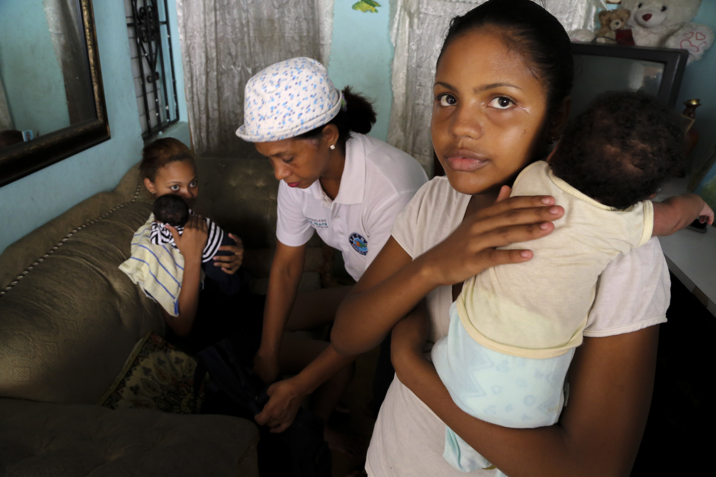 Young mothers during a Physician's for Peace mentoring and counseling session in The Dominican Republic.
