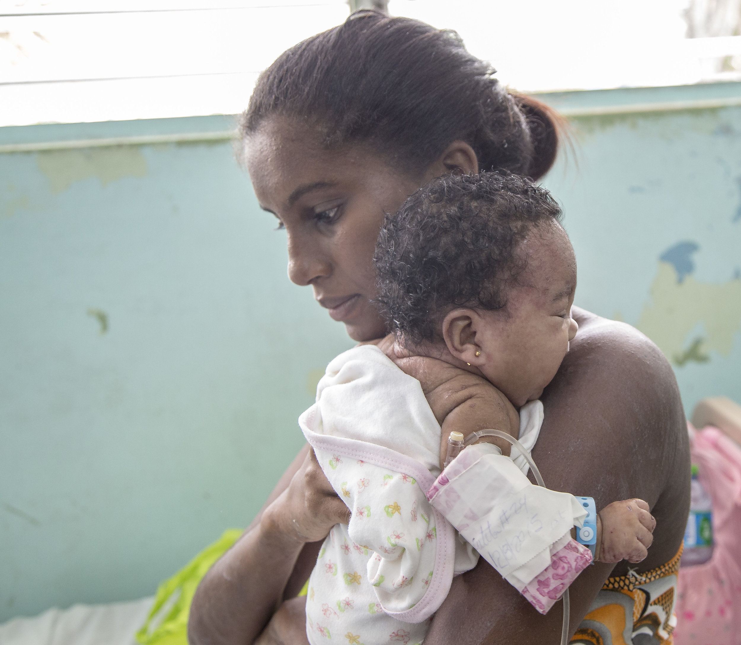 A mother and sick child at a Physician's for Peace sponsored clinic in The Dominican Republic.