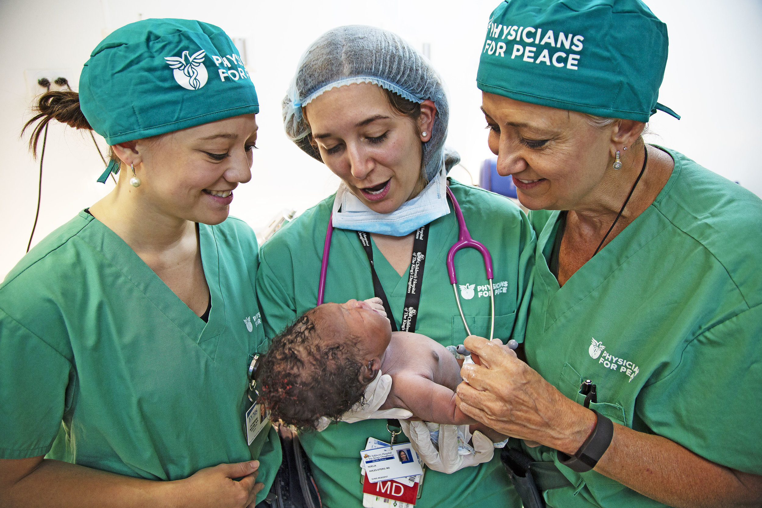 Physician's for Peace Obstetricians with a newborn in The Dominican Republic.