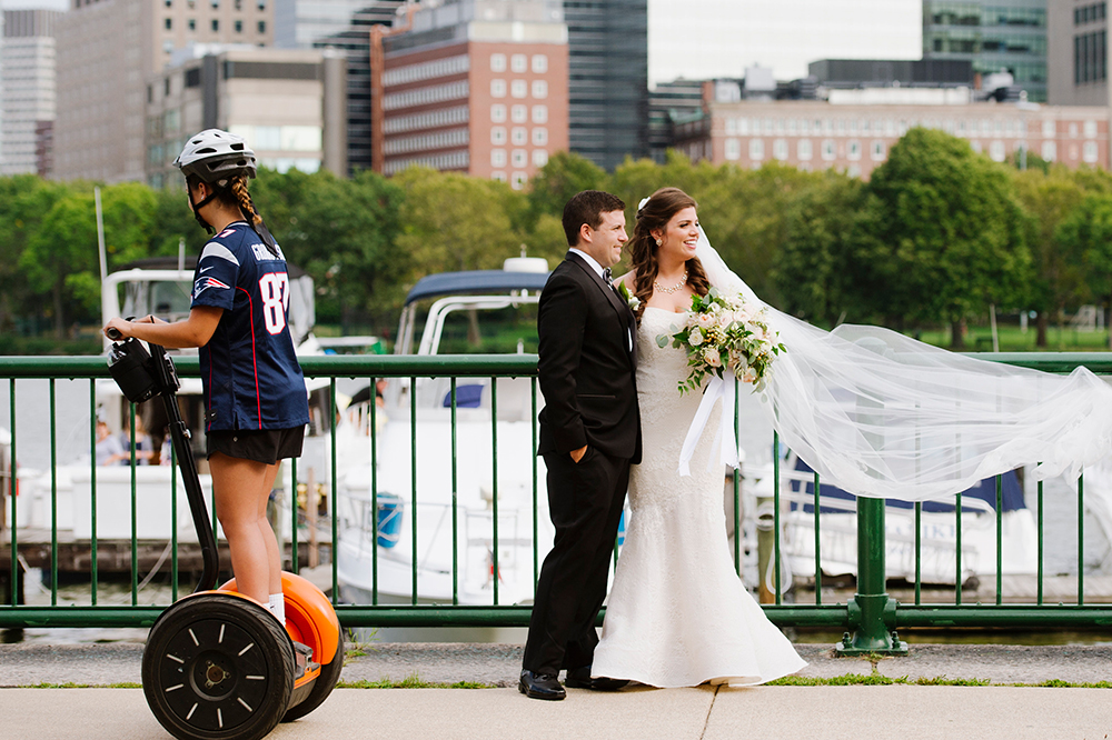 Bride and groom pose for photo along the Boston Esplanade