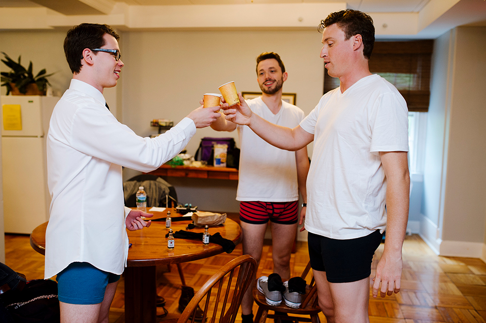 Groomsmen toast before wedding at The Connors Center, Dover