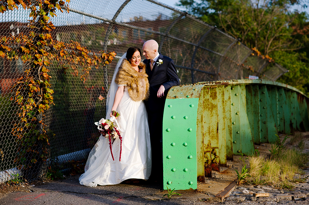 Bride and Groom pose for photo at Artists for Humanity, Boston