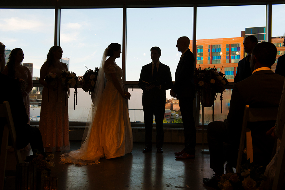 silhouette of bride and groom during ceremony at Artists for Humanity