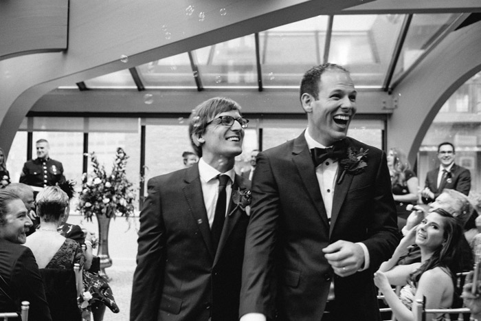 A gay couple tie the knot at the Bostononian during their October Wedding