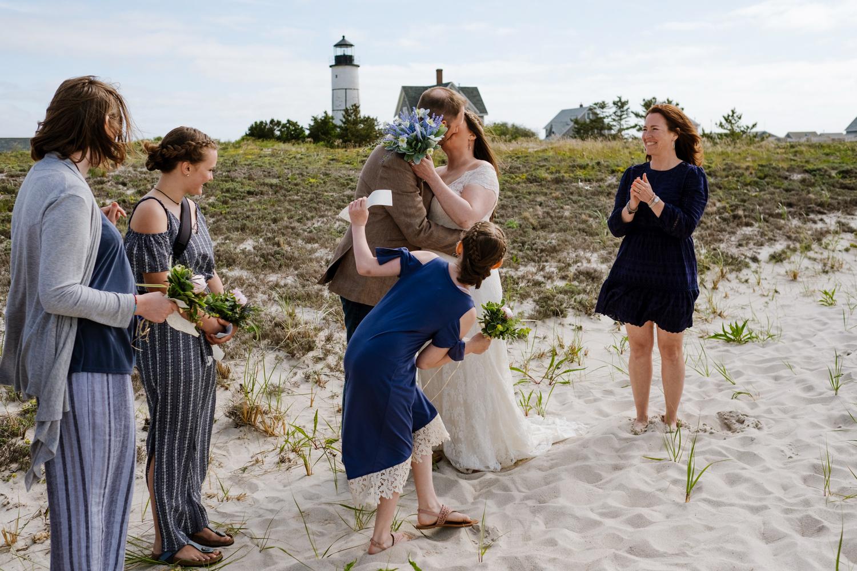 Bride_and_groom_kiss_on_beach