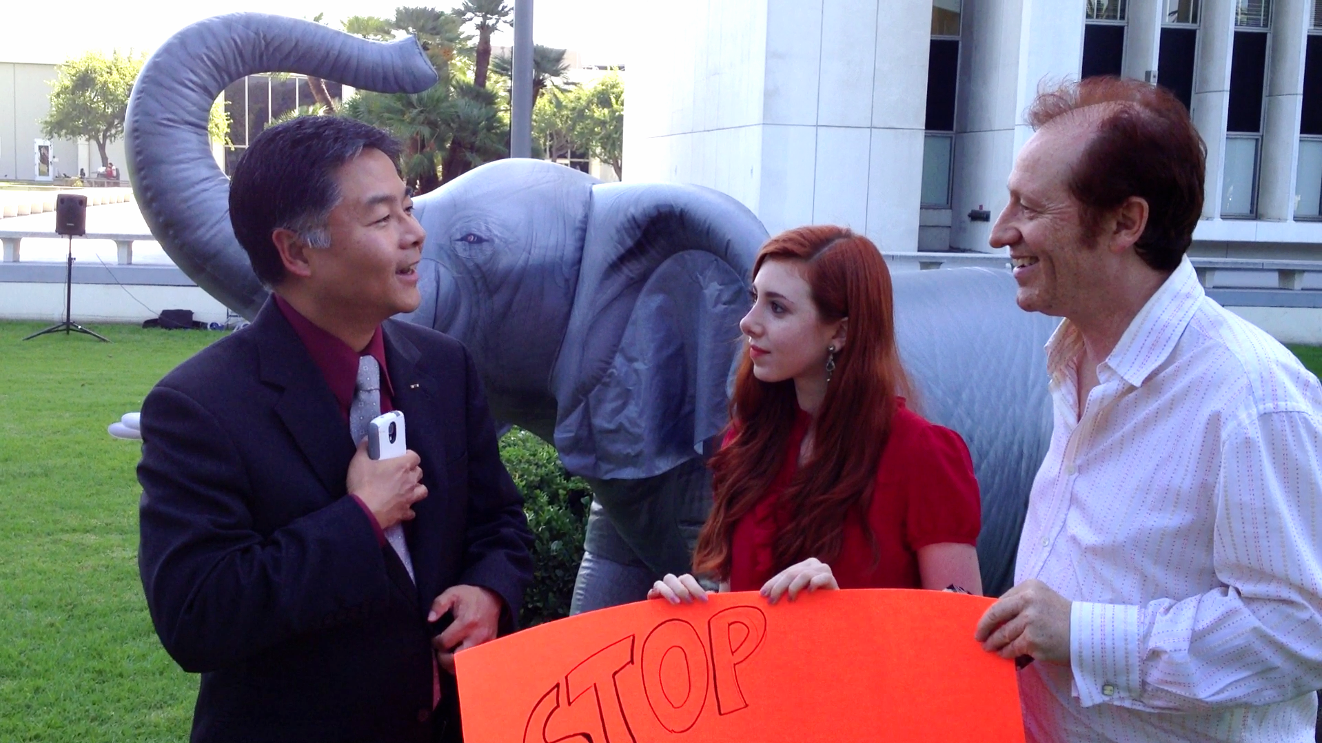 Congressman Ted Lieu meeting Huxleys at March For Elephants at the Federal building in LA