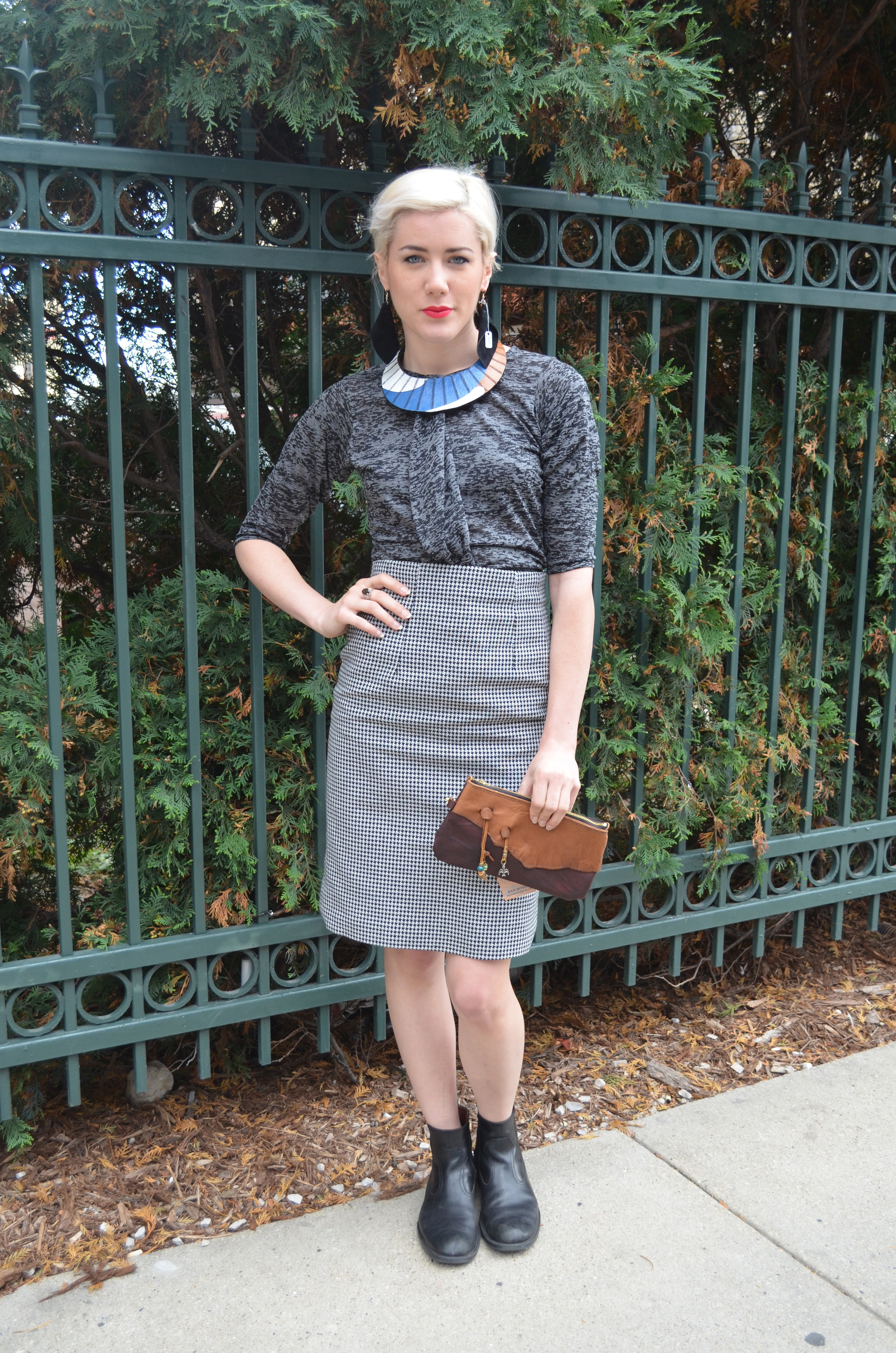 Necklace by  Bethany Procopio   Blouse by  Tessa Koller   Skirt by  Theresa Dougar   Clutch by  Kari Demien   Earrings by  Bree Rose