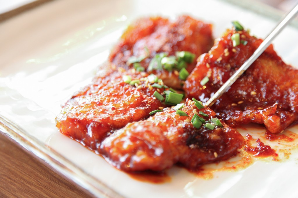 The mild to medium spicy Seasoned Raw Fish (회무침).