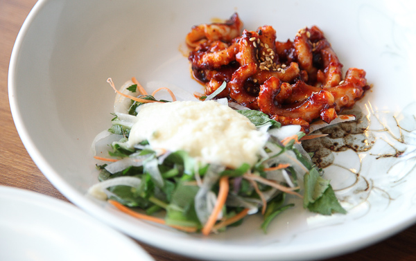 The Fried Octopus (낙지볶음) with perilla leaf salad. If the octopus is too spicy, district your taste buds with the herby perilla.