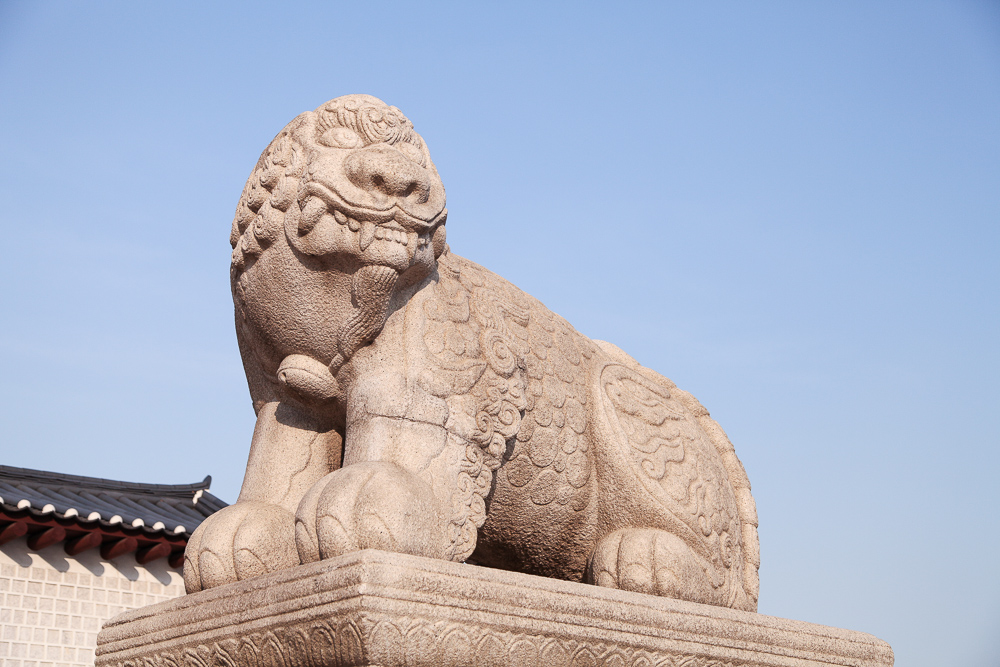"The lion-unicorn, known as ""haitai,"" sits in front of Gyeongbokgung Palace to protect the city from natural disasters."