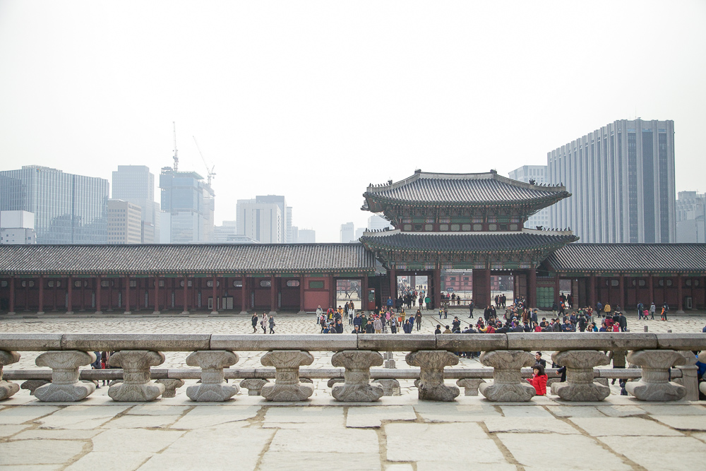 The traditional and modern architecture mash-up. From the raised platform of the Throne Hall looking south, you'll see the tall buildings lined up next to Gwanghwamun Plaza.