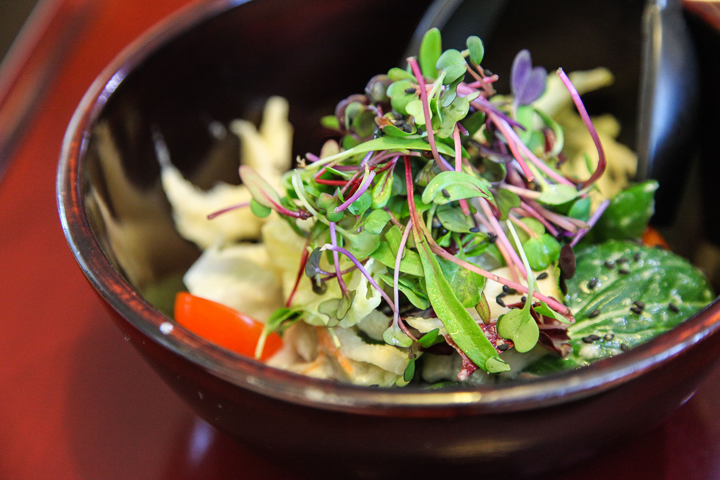 "Wild ""deodeok"" root mixed with seasonal vegetables and pine nut dressing (더덕샐러드 = Deodeok Salad)."