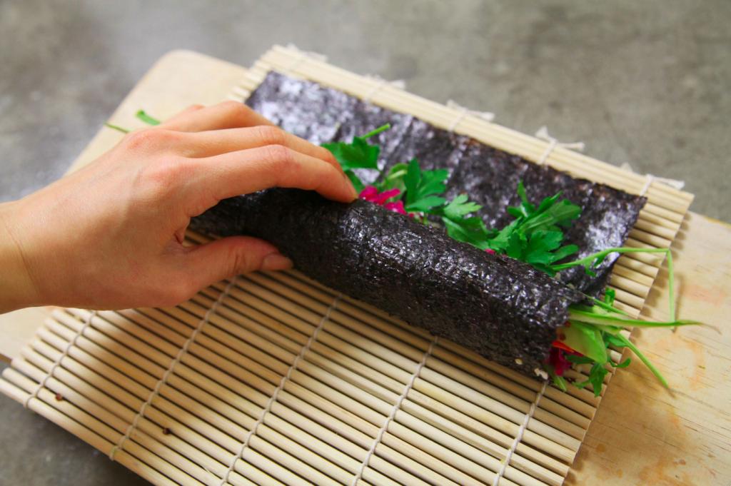 vegan-kimchi-kimbap-recipe-4-roll-it-up-SMALLER-1024x681.png