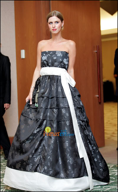 Nicky Hilton at Seoul's Coex Intercontinental Hotel to launch her clothing line. Her hanbok is also produced by Kim MeHee.