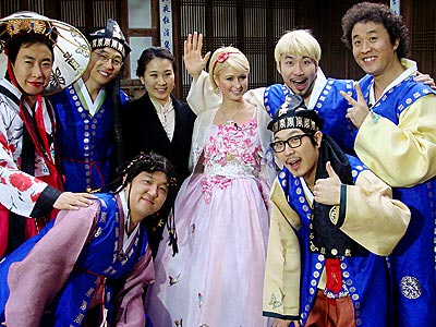"Paris Hilton with the cast members of ""Infinity Challenge."" The person all the way to the right is a man (Park Myeongsu) dressed as a female!"