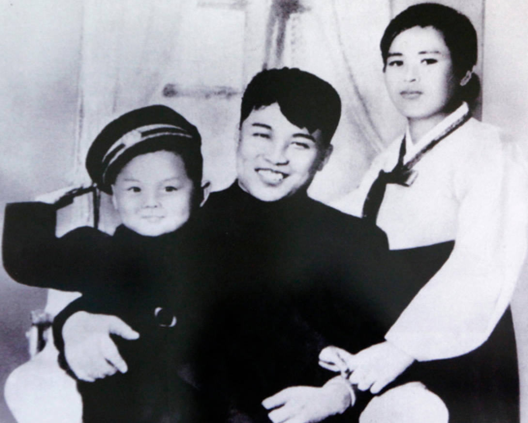 Kim Il Sung's family portrait. From left to right: Kim Jong Il (Kim Il Sung's son), Kim Il Sung, and Kim Jong Suk (Kim Il Sung's first wife).