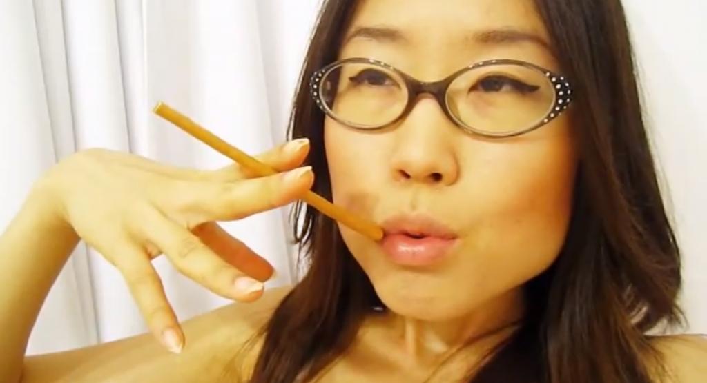 Professor Oh smoking a stick of Nude Pepero.