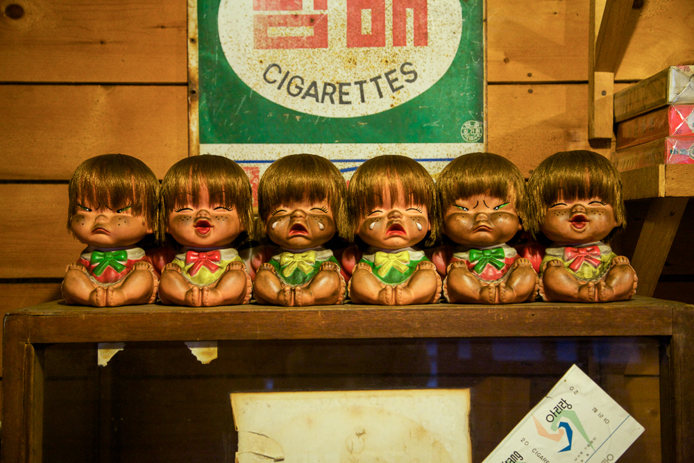 Old-school dolls on display at the reproduction of Seoul slums.