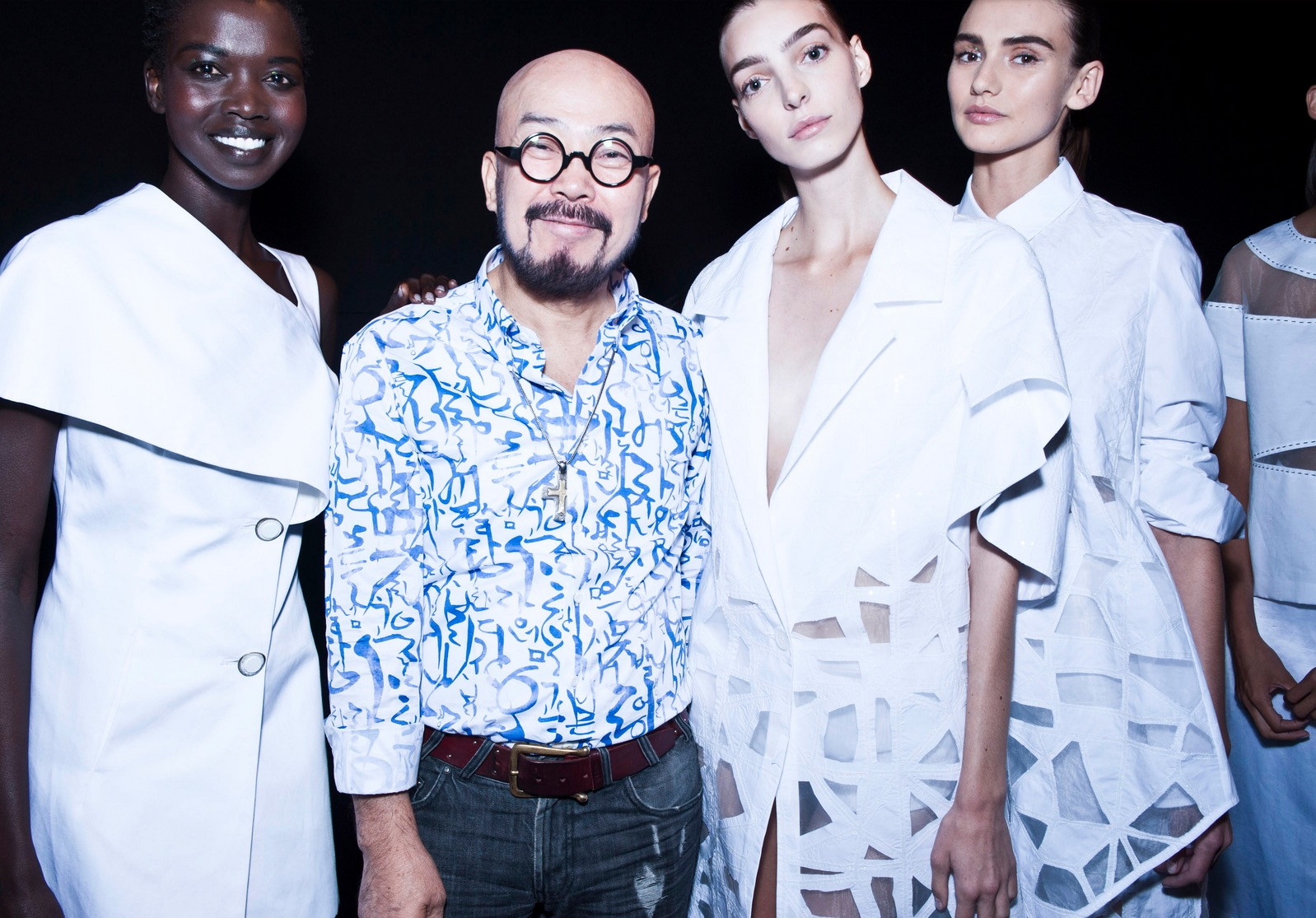 Lie Sangbong with his models, wearing Hangeul-inspired pattern  (Photo:  Liesangbong.com )
