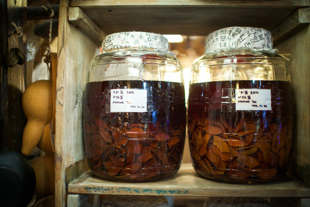 "Jars of tea inside the famously long-titled cafe called ""Moon Bird Does Thinks of Only the Moon."""