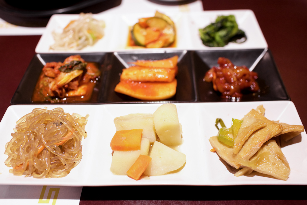 Complimentary banchan (side dishes) served on every visit.