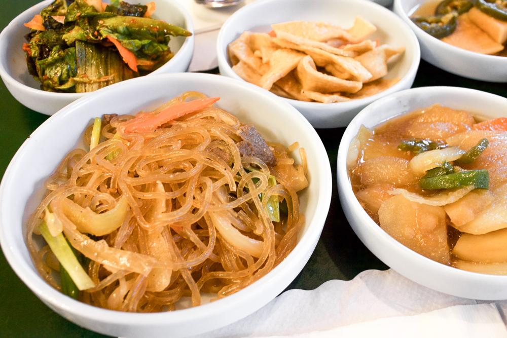 Japchae (Korean glass noodles) on the left. My preferred side dish at Choi's Korean Restaurant.