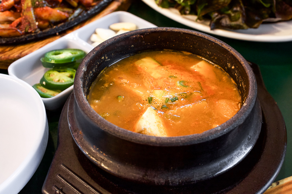 The Dwenjang Jjigae arrives boiling. By the time I snapped out the hypnosis, the glorious boiling faded away. That's when I captured this shot.