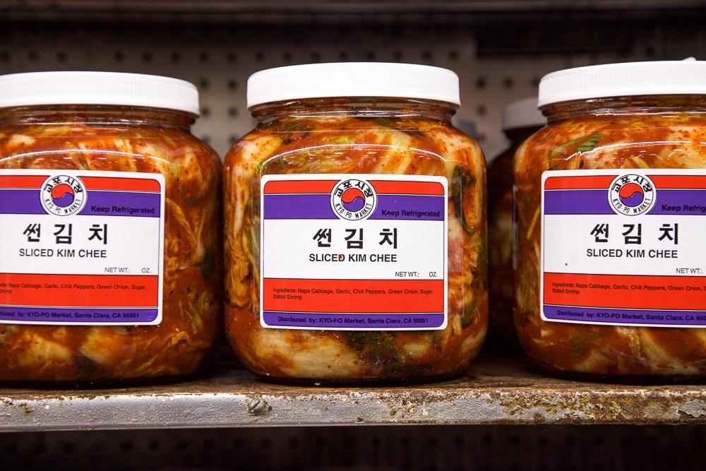Glass jar of napa cabbage kimchi.