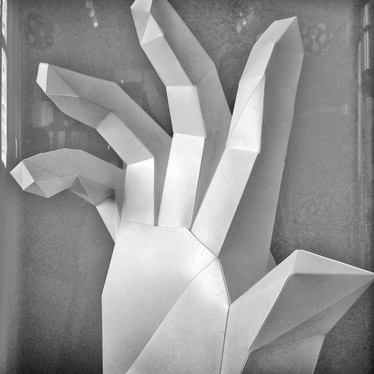 Oversized 3D hand constructed with laser cut styrene pieces. The hand was modeled in 3D using Rhino, and then the model was deconstructed into flattened 2D components.