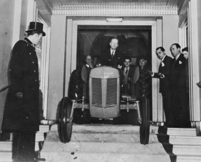 This is the iconic image of Harry Ferguson, driving his TE20 out of the ballroom!