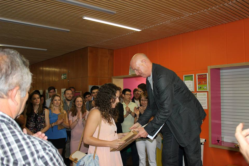 Rosie receiving her prizes from KSA Head of School Don Gray