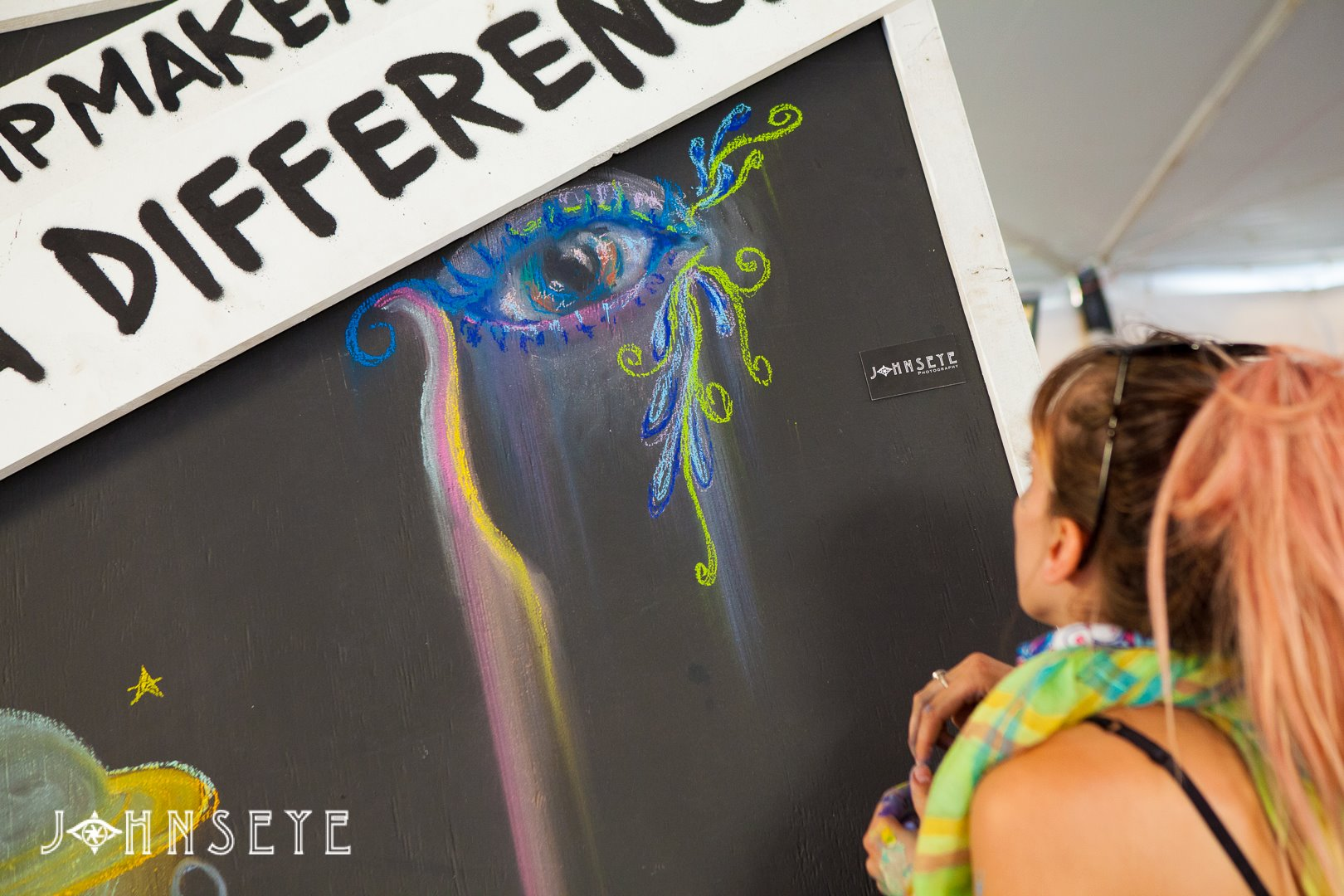 Taking a minimal break from live painting at Summer Camp Music Festival 2015, to live chalk drawing for the Make A Difference community chalk board.